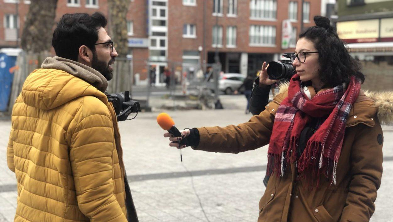 Aktionsstand Kalker Post: Fluchtursachen zum Anziehen – Fluchtursachen zum Telefonieren